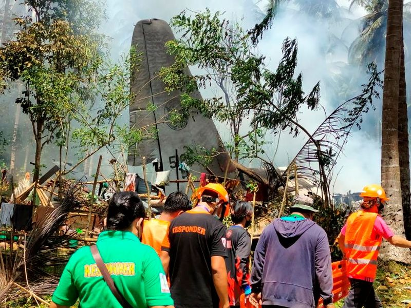 Some Philippine troops jump before military plane crashes in flames, killing at least 45