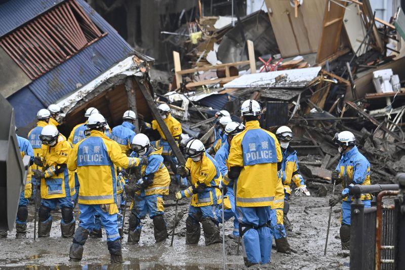 Rescuers in Japan hunt for 80 missing after deadly landslides
