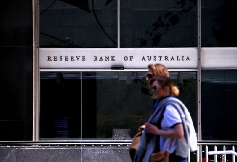 Australia's cbank tapers QE but affirms low rates outlook