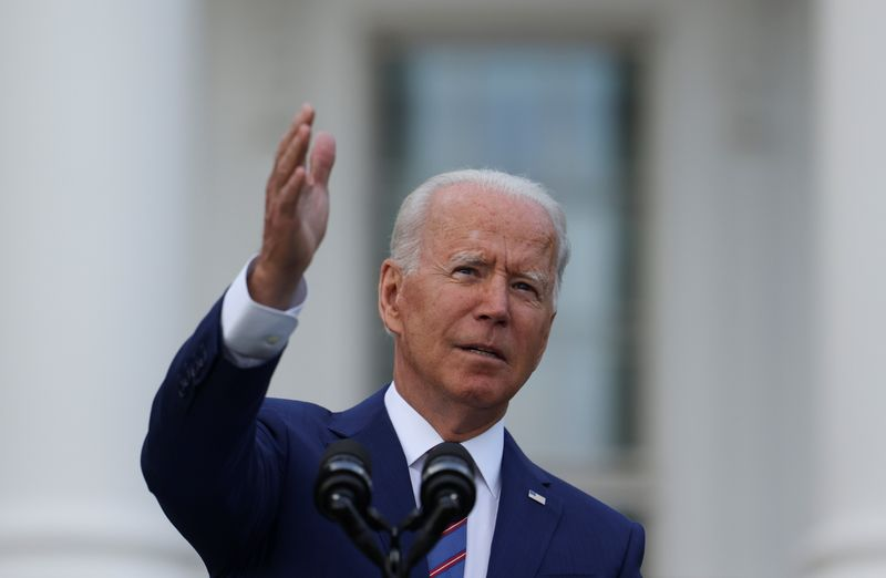 Biden seeks to lift limits on farmer deals with meat processors, tractor makers