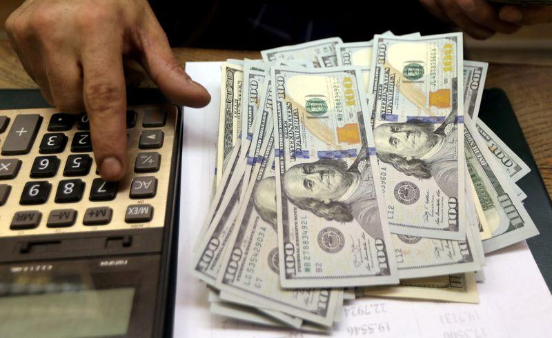 U.S. dollar little changed following Fed minutes