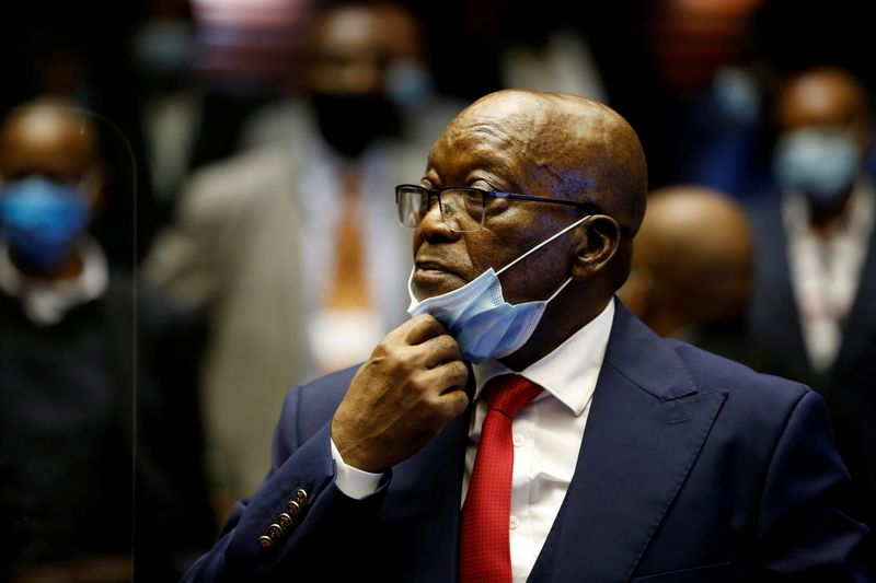 South Africa's Zuma hands himself over to police to begin sentence