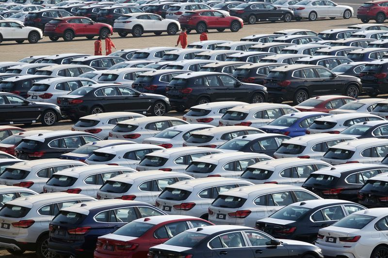 China's auto sales down 12.4% in June - industry association