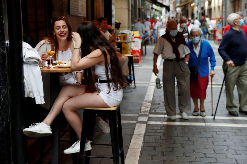 Spanish tourist hotspots seek return to curfews as youth infections rage